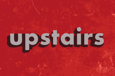 upstairs: upstairs vector word on red concrete wall