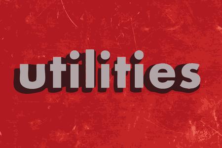 utilities: palabra vector utilidades en rojo muro de hormig�n
