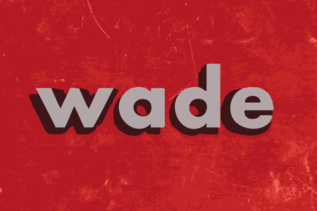wade: wade vector word on red concrete wall