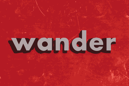 wander: wander vector word on red concrete wall