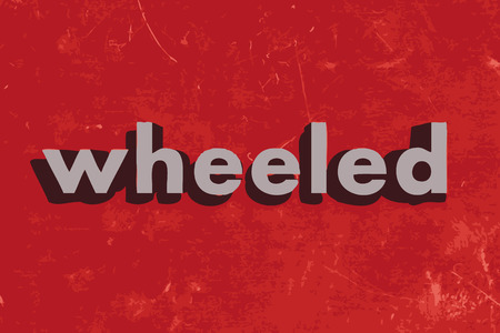 wheeled: wheeled vector word on red concrete wall
