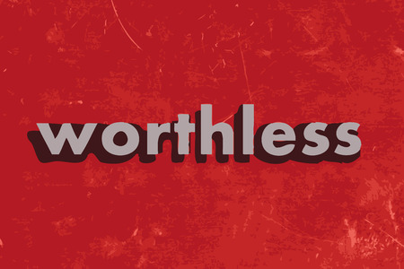 worthless: worthless vector word on red concrete wall