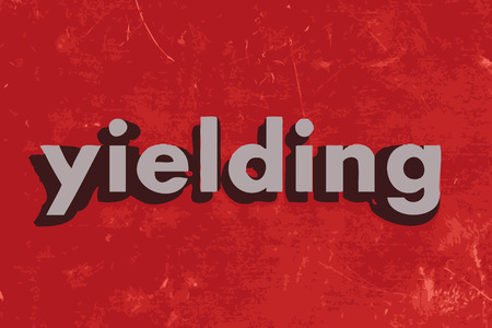 yielding: yielding vector word on red concrete wall