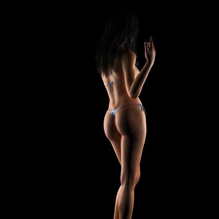 curvaceous: Sexy brunette bikini woman posing in dark studio