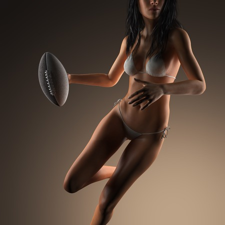 sexy abs: Beautiful young woman wearing bikini holding football