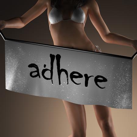 adhere: adhere word on banner and bikiny woman Stock Photo