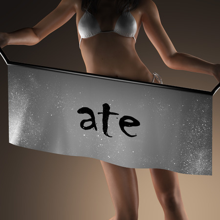 ate: ate word on banner and bikiny woman Stock Photo