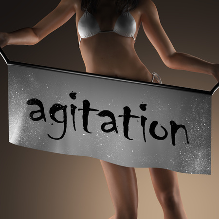 agitation: agitation word on banner and bikiny woman Stock Photo