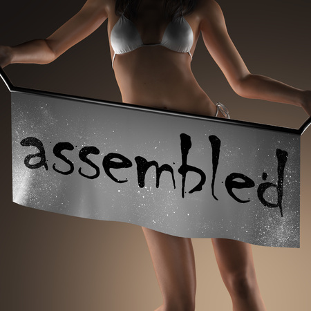 assembled: assembled word on banner and bikiny woman Stock Photo