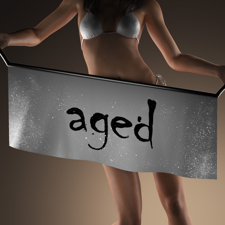 aged: aged word on banner and bikiny woman