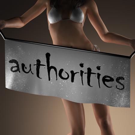 authorities: authorities word on banner and bikiny woman Stock Photo