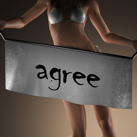 posing  agree: agree word on banner and bikiny woman Stock Photo