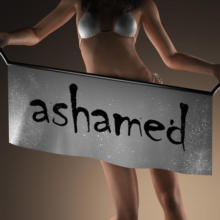 avergonzado: palabra verg�enza en banner y mujer bikiny Foto de archivo