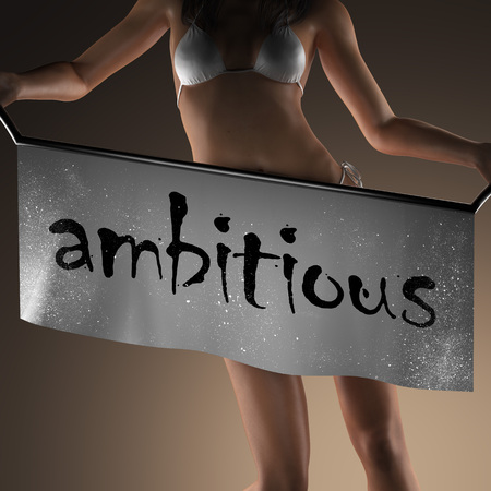ambitious: ambitious word on banner and bikiny woman