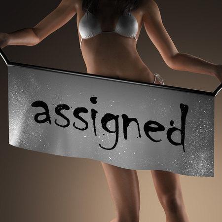 assigned: assigned word on banner and bikiny woman
