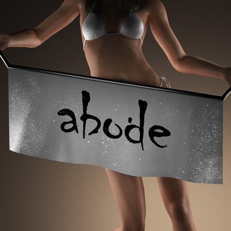 abode: abode word on banner and bikiny woman
