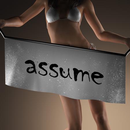 assume: assume word on banner and bikiny woman Stock Photo