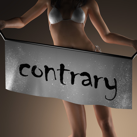 contrary: contrary word on banner and bikiny woman
