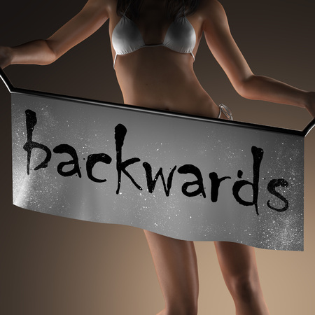 backwards: backwards word on banner and bikiny woman Stock Photo