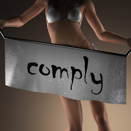 comply: comply word on banner and bikiny woman