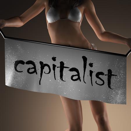 capitalist: capitalist word on banner and bikiny woman Stock Photo