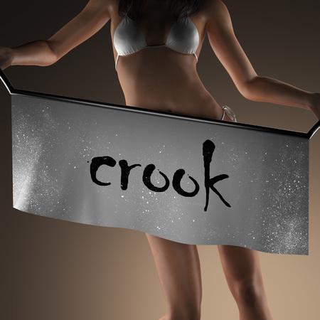 crook: crook word on banner and bikiny woman