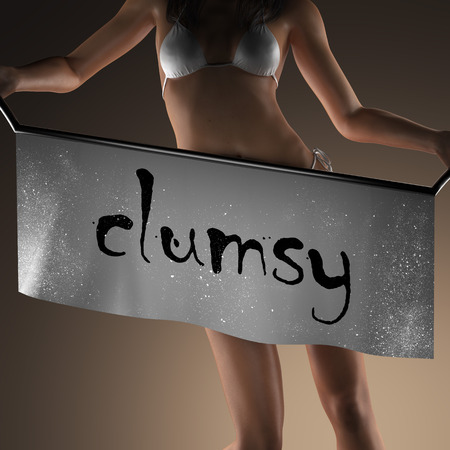 clumsy: clumsy word on banner and bikiny woman