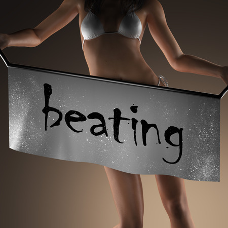 beating: beating word on banner and bikiny woman Stock Photo