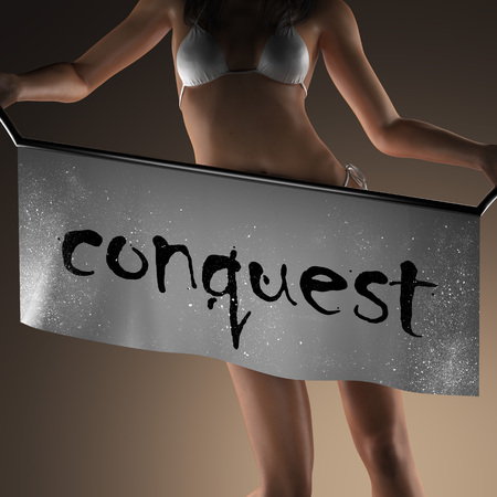 conquest: conquest word on banner and bikiny woman Stock Photo
