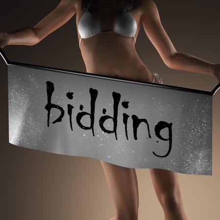 bidding: bidding word on banner and bikiny woman Stock Photo