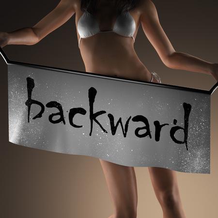backward: backward word on banner and bikiny woman Stock Photo