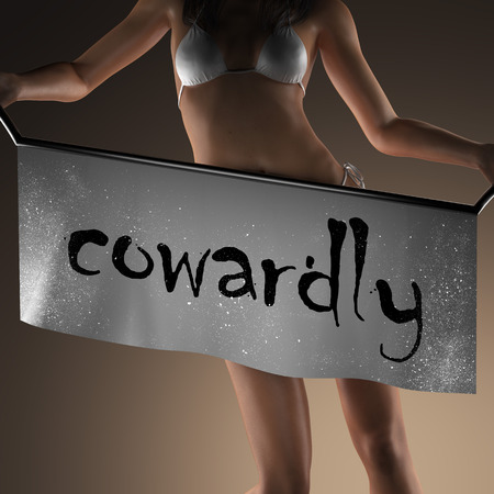 cowardly: cowardly word on banner and bikiny woman Stock Photo