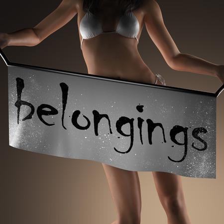 belongings: belongings word on banner and bikiny woman
