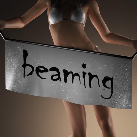 beaming: beaming word on banner and bikiny woman