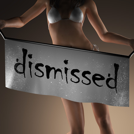 dismissed: dismissed word on banner and bikiny woman Stock Photo