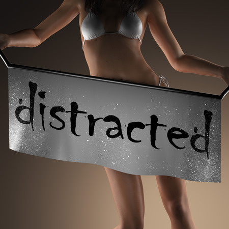 distracted: distracted word on banner and bikiny woman