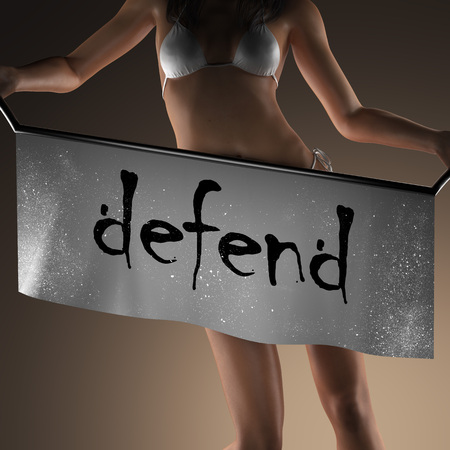 defend word on banner and bikiny woman Stock Photo