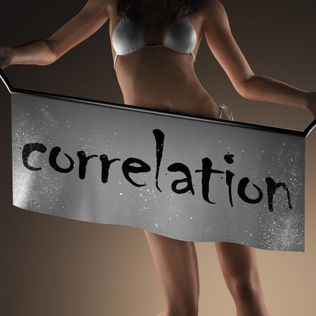 correlation: correlation word on banner and bikiny woman Archivio Fotografico