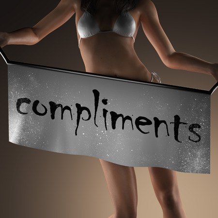 compliments: compliments word on banner and bikiny woman Stock Photo