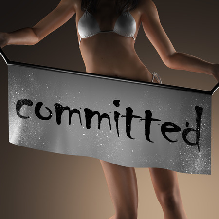 committed: committed word on banner and bikiny woman
