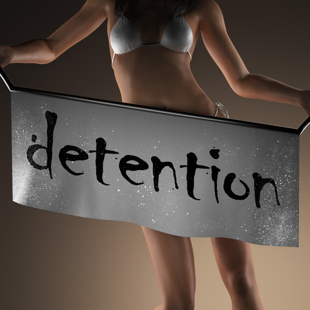 detention: detention word on banner and bikiny woman Stock Photo