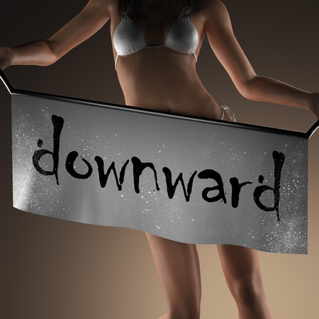 downward: downward word on banner and bikiny woman Stock Photo