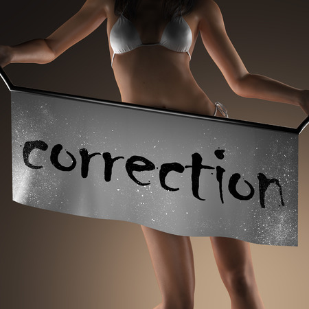 correction: correction word on banner and bikiny woman