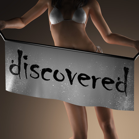 discovered: discovered word on banner and bikiny woman