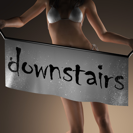 downstairs: downstairs word on banner and bikiny woman Stock Photo