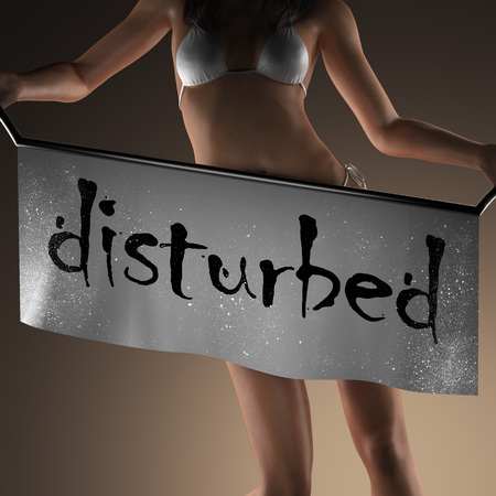 disturbed: disturbed word on banner and bikiny woman