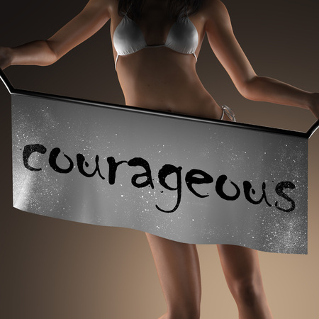 courageous: courageous word on banner and bikiny woman