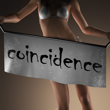 coincidence: coincidence word on banner and bikiny woman Stock Photo
