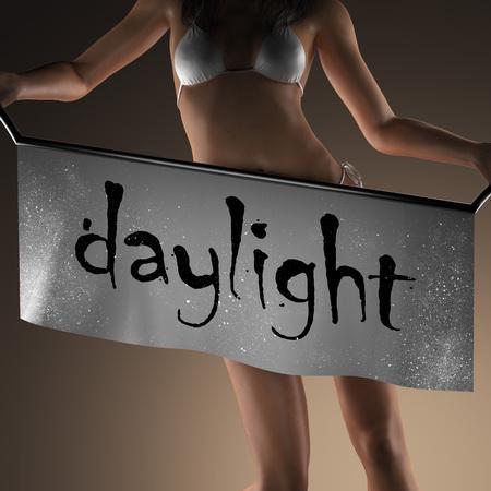daylight: daylight word on banner and bikiny woman Stock Photo