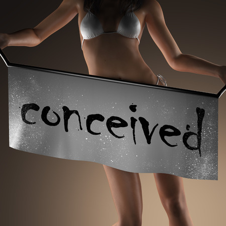 conceived: conceived word on banner and bikiny woman